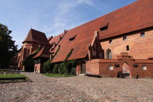 The red brick cobblestones and red tile roof of Malbork Castle.photo by Morgan Thomas