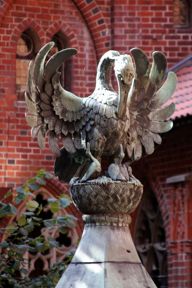 A large bronze bird adorns the top of the well.photo by Morgan Thomas