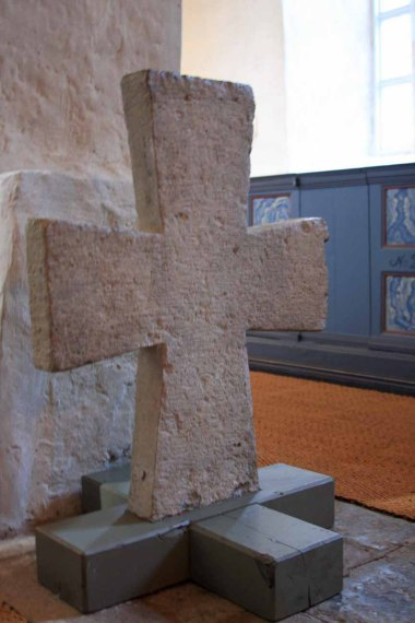 A stone cross in the 14th-century church.