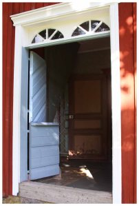 Blue door, red house at the Hermas homestead