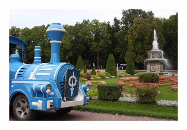 A colorful blue tram runs throughout the 500 hectare complex